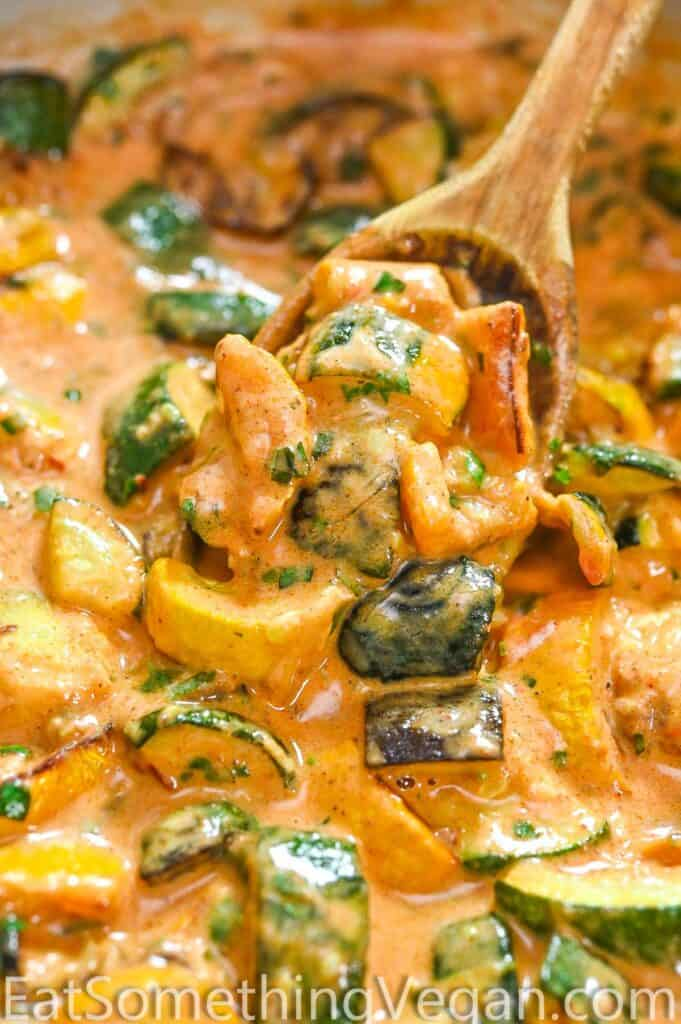 Creamy Zucchini Sauce on a wooden spoon