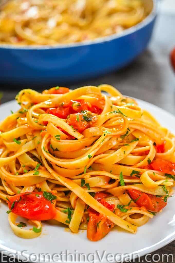 fettuccine in tomato sauce on a white plate