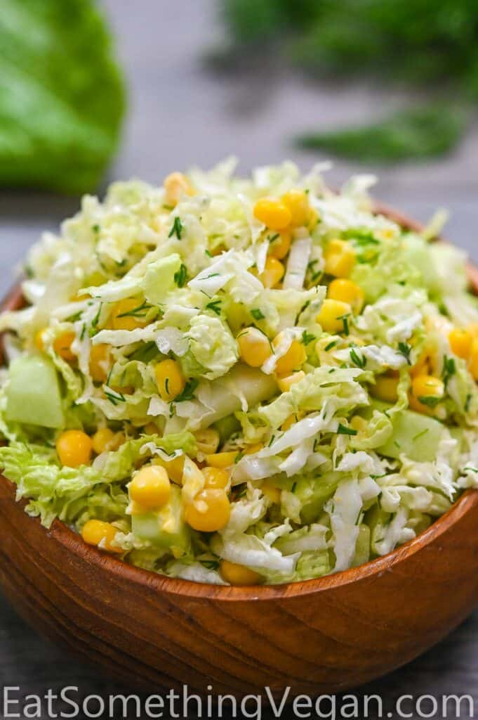 Napa Cabbage Salad in a small wooden bowl