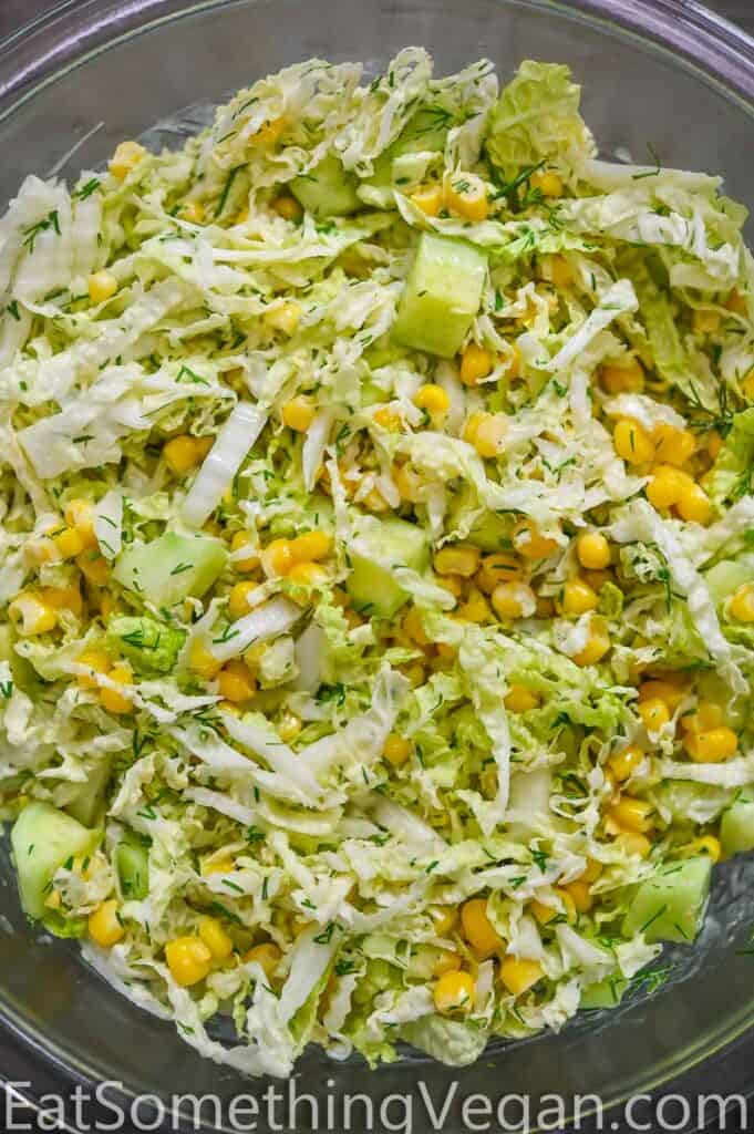 Napa cabbage salad in a glass bowl