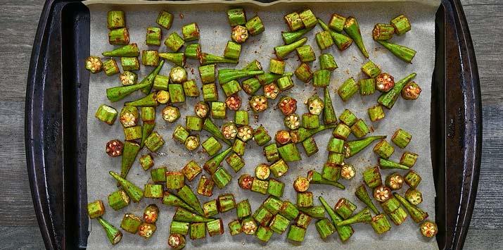 spreading okra on a tray