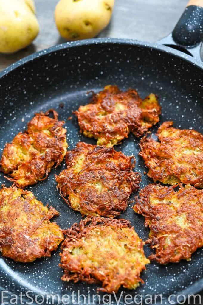 vegan potato pancakes in the skillet