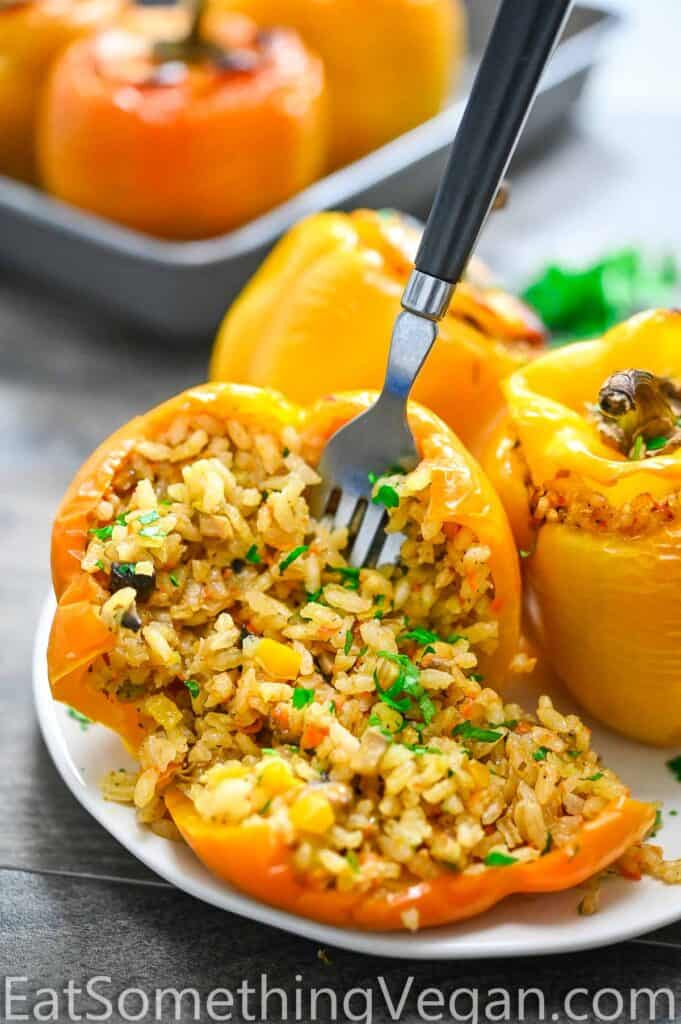 Vegan stuffed pepper with a fork in it