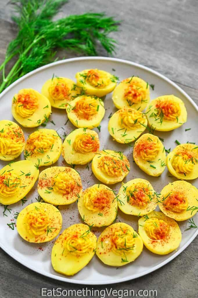Vegan Deviled Eggs on a plate with dill on the background
