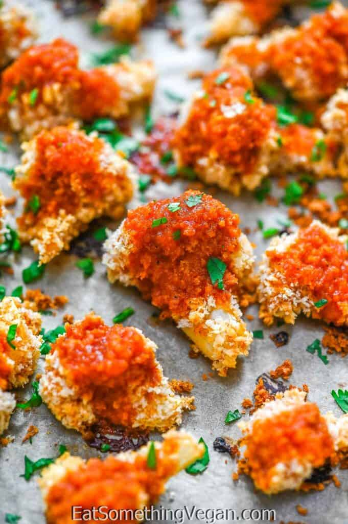 Cauliflower Bites on a baking tray garnished with parsley