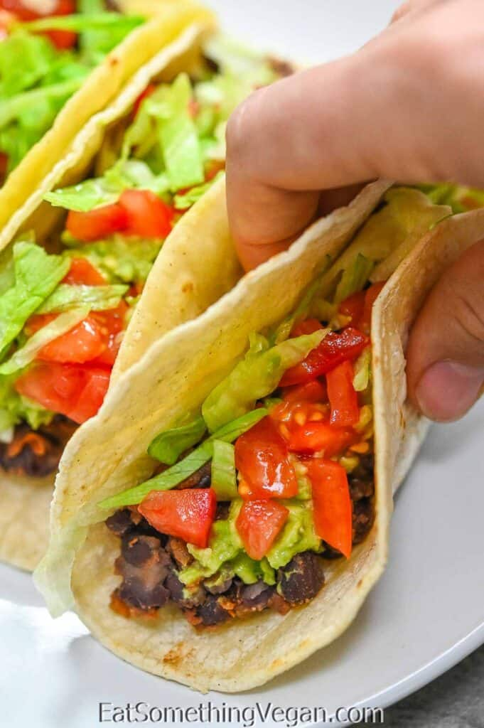 holding Black Bean Tacos in hand