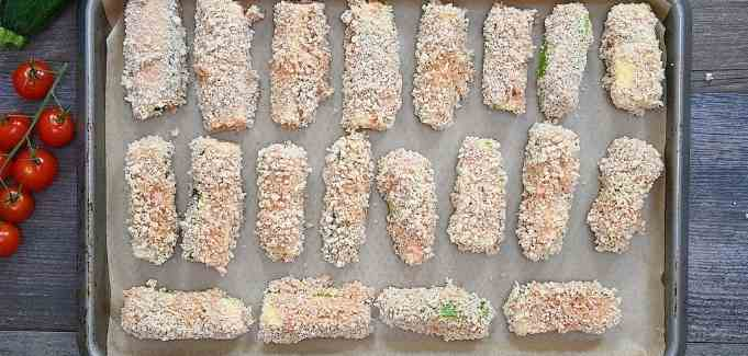 arranging zucchini fries on a baking tray