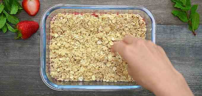 topping the strawberries