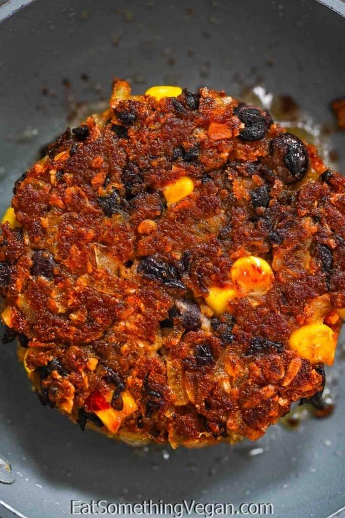 fried Vegan Black Bean Burger patty on a skillet