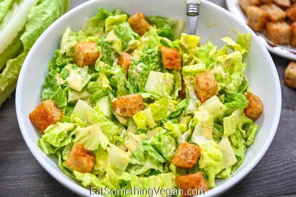Vegan Caesar salad in a white bowl