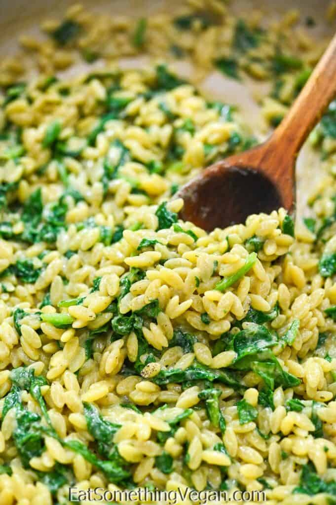Vegan Spinach Orzo on a wooden spoon