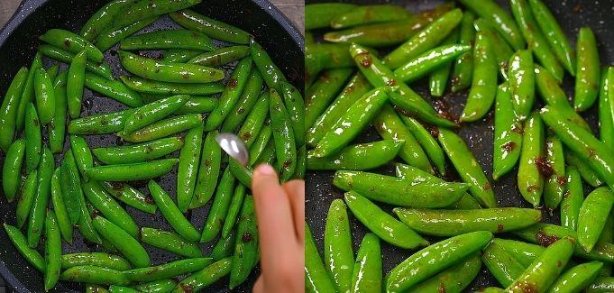 adding sesame oil to the peas