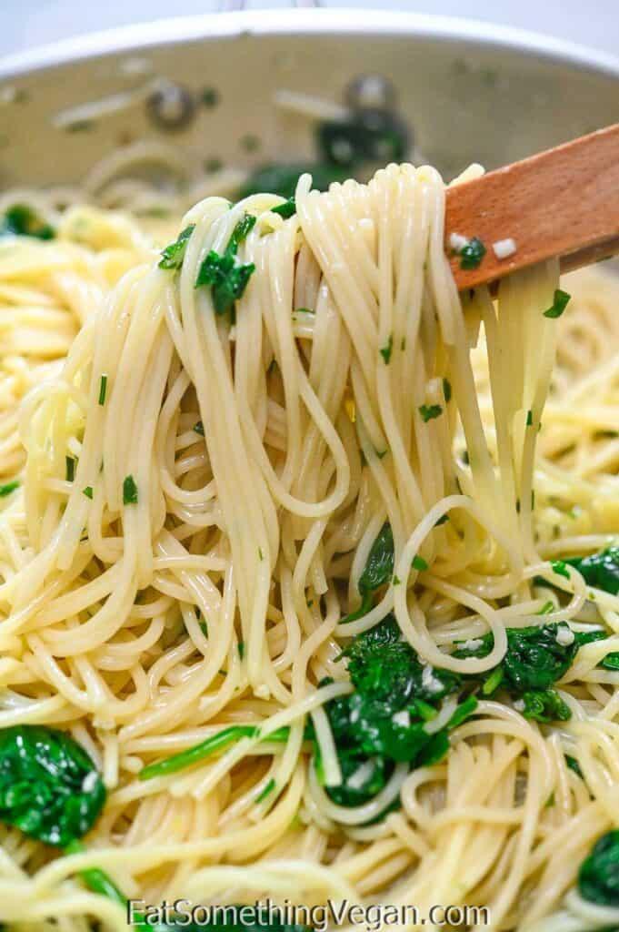 Spaghetti Aglio e Olio with Spinach in a skillet